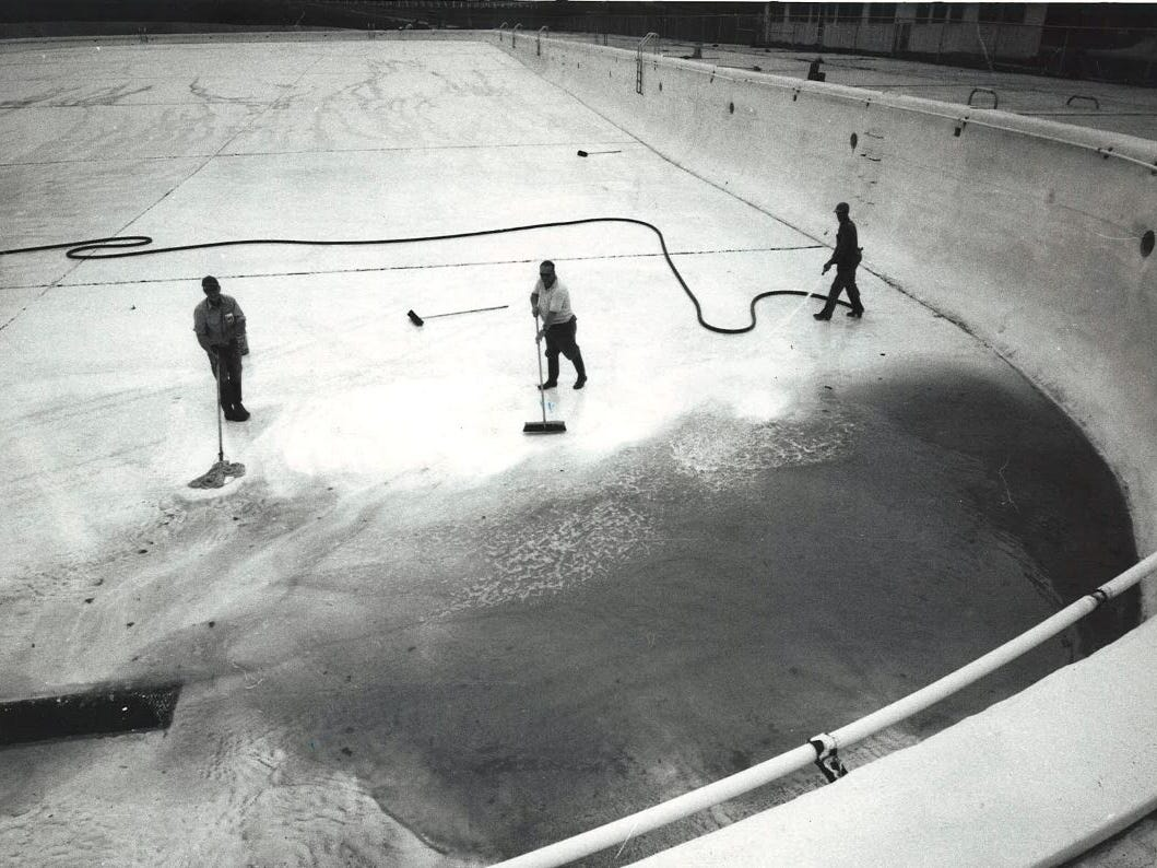 From 1971: The 150-foot by 350-foot Camp Dodge pool gets scrubbed down before filling begins for the 1971 swim season. From left, Marion Mishler of Camp Dodge, Don Page of Des Moines and Sam Lamphier of Granger make sure it's clean before the first of 3 million gallons pour in.