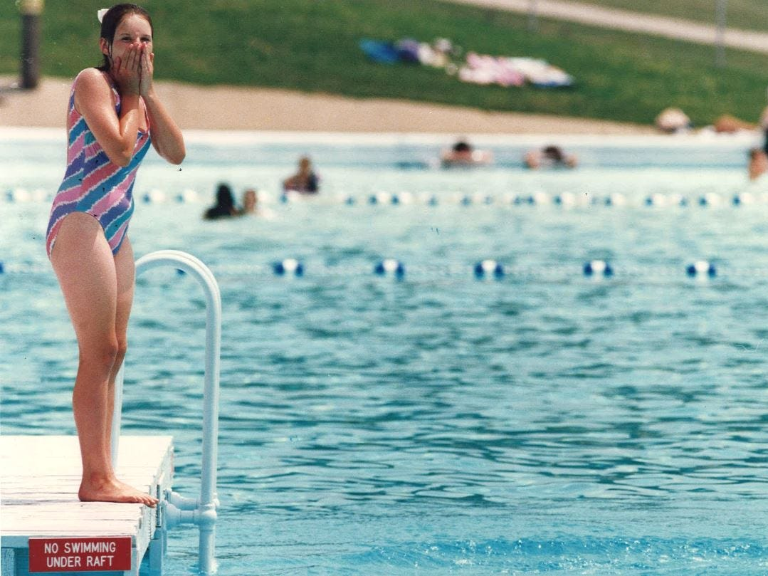 From 1992: Lori Wilson reacts after friend Misty Miller dove off a platform in the Camp Dodge pool.