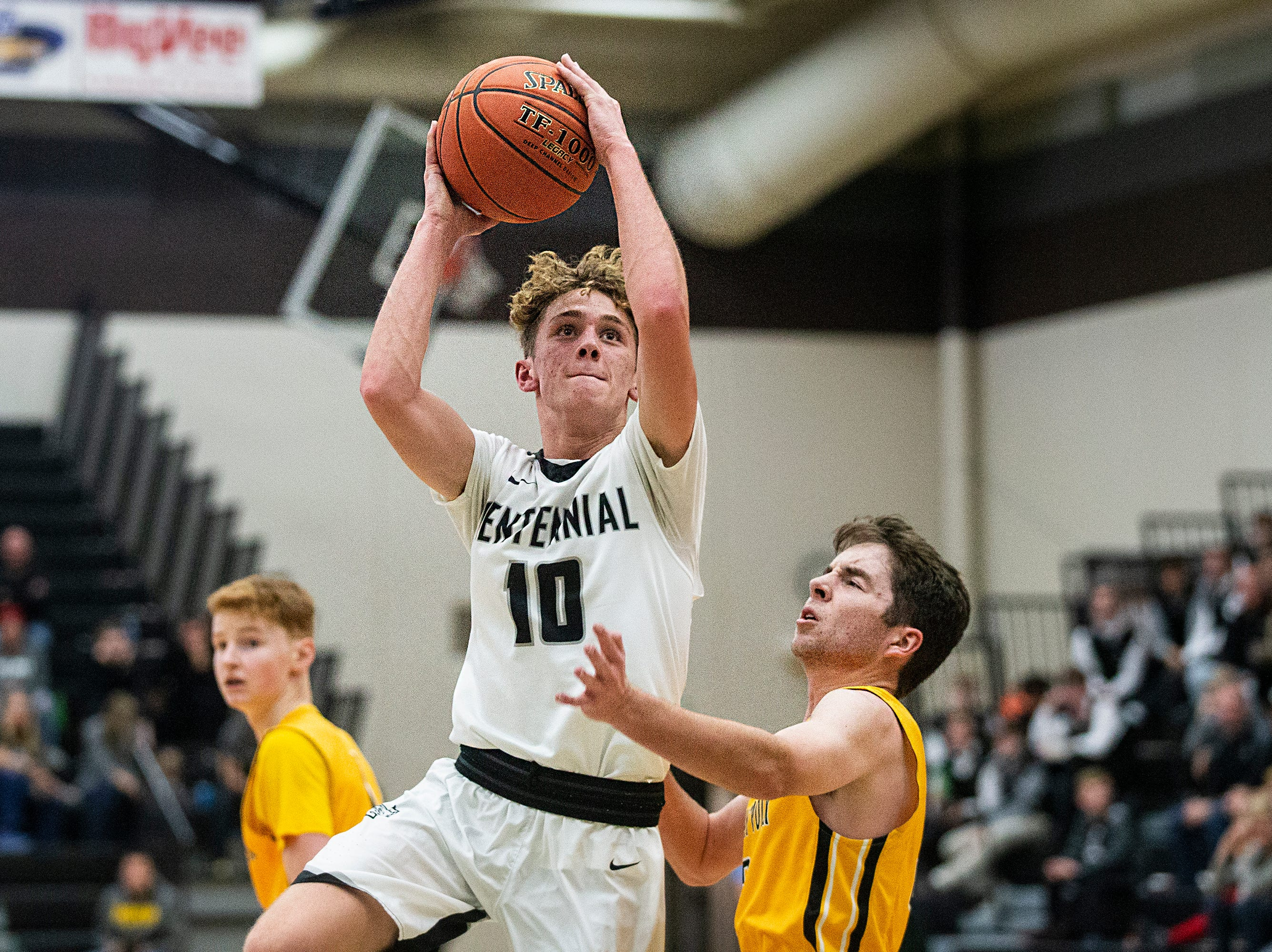 Centennial's Caleb Van Meter shoots the ball during the Southeast Polk vs. Ankeny Centennial boy's basketball game on Tuesday, Nov. 27, 2018, at Ankeny Centennial High School.