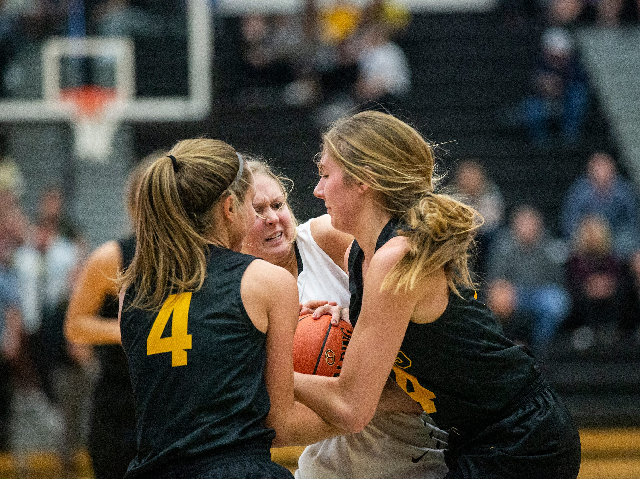 SEP's Jaycie Elliott and Kadence Williams and Centennial's Lily King fight for a jump ball during the Southeast Polk vs. Ankeny Centennial girls' basketball game on Tuesday, Nov. 27, 2018, at Ankeny Centennial High School.