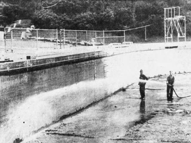 From 1934: Harry C. Suhr, left, utilities officer at Camp Dodge, and Johnnie Johnson, workman from the playground department, began flushing out the big pool to get it ready to open for the swimming season.