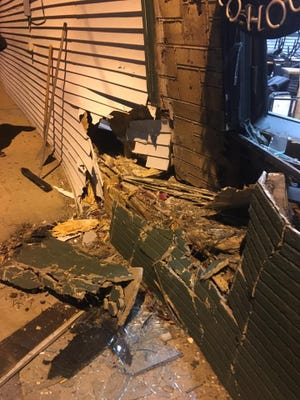 Henry J's Taco House in Des Moines is closed after a car hit the building early Wednesday and pushed in a wall.