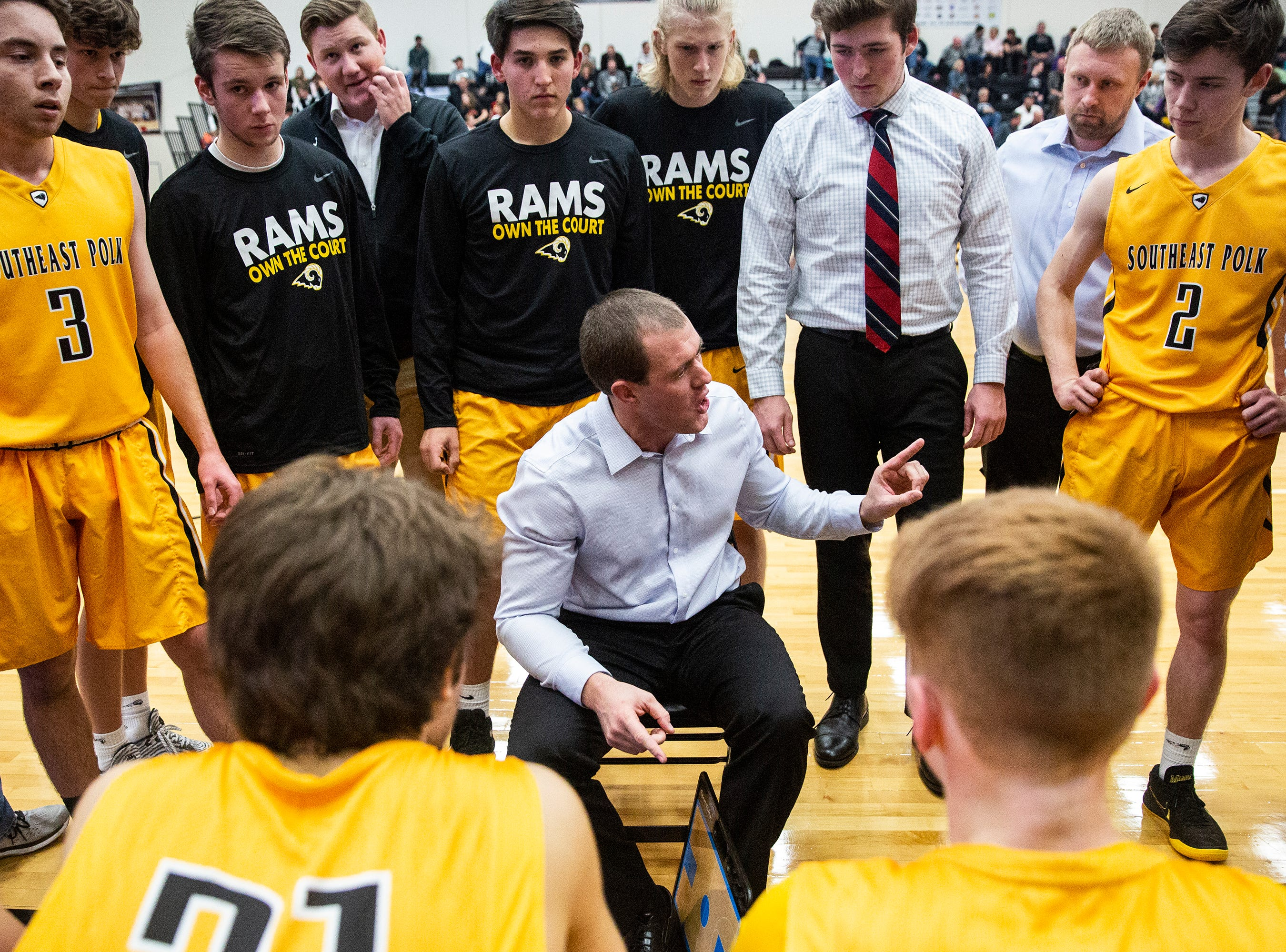 SEP Coach Alan Jenkins talks to his team during a time out during the Southeast Polk vs. Ankeny Centennial boy's basketball game on Tuesday, Nov. 27, 2018, at Ankeny Centennial High School.