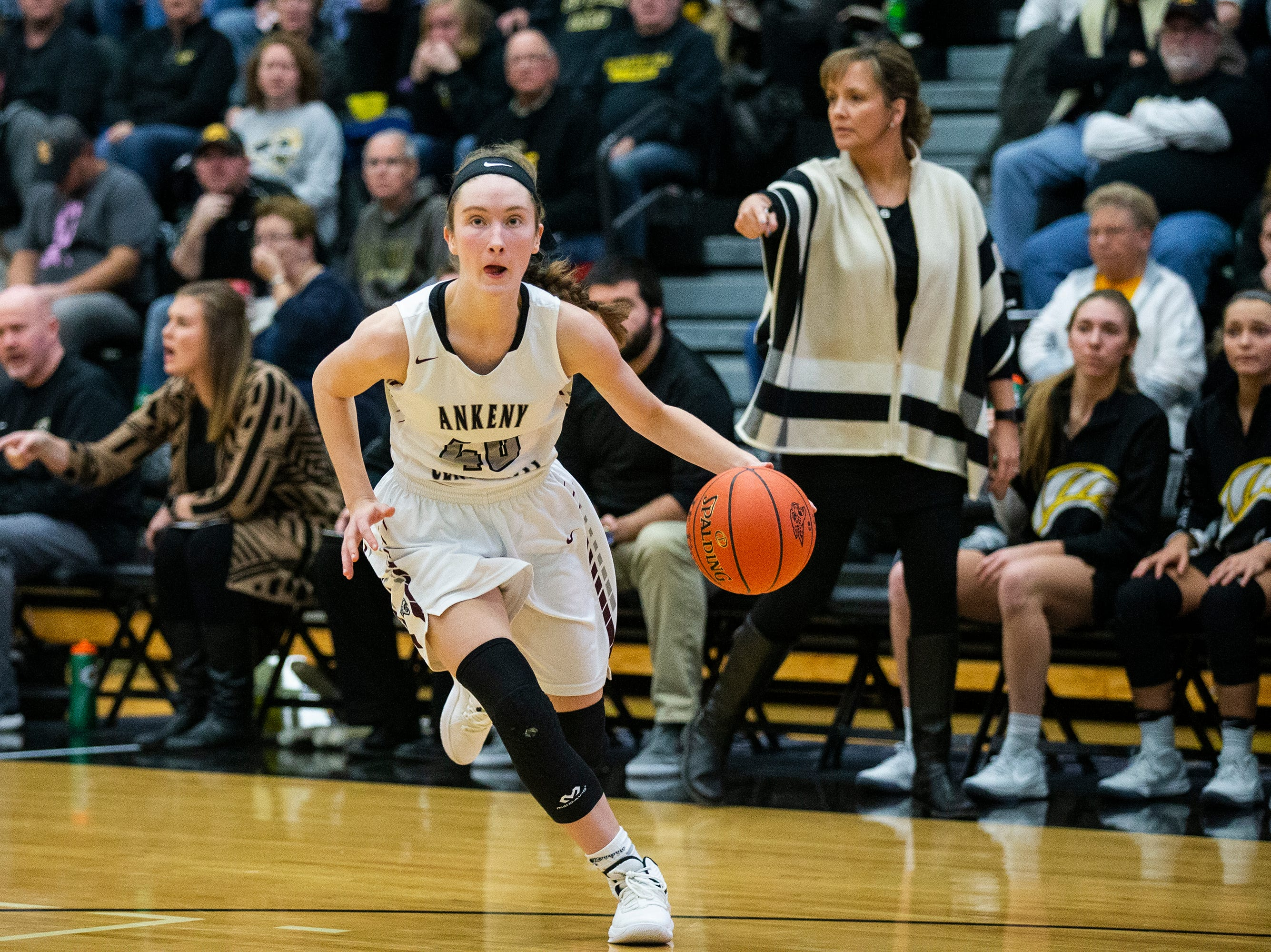 Centennial 's Meg Burns brings the ball down the court during the Southeast Polk vs. Ankeny Centennial girls' basketball game on Tuesday, Nov. 27, 2018, at Ankeny Centennial High School.