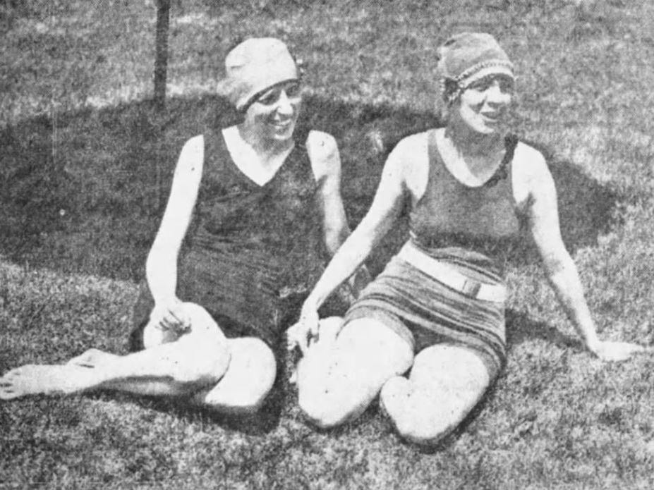 Gertrude Brock and Mary Kinball, both of Des Moines, enjoy themselves on the grass near the Camp Dodge pool.
