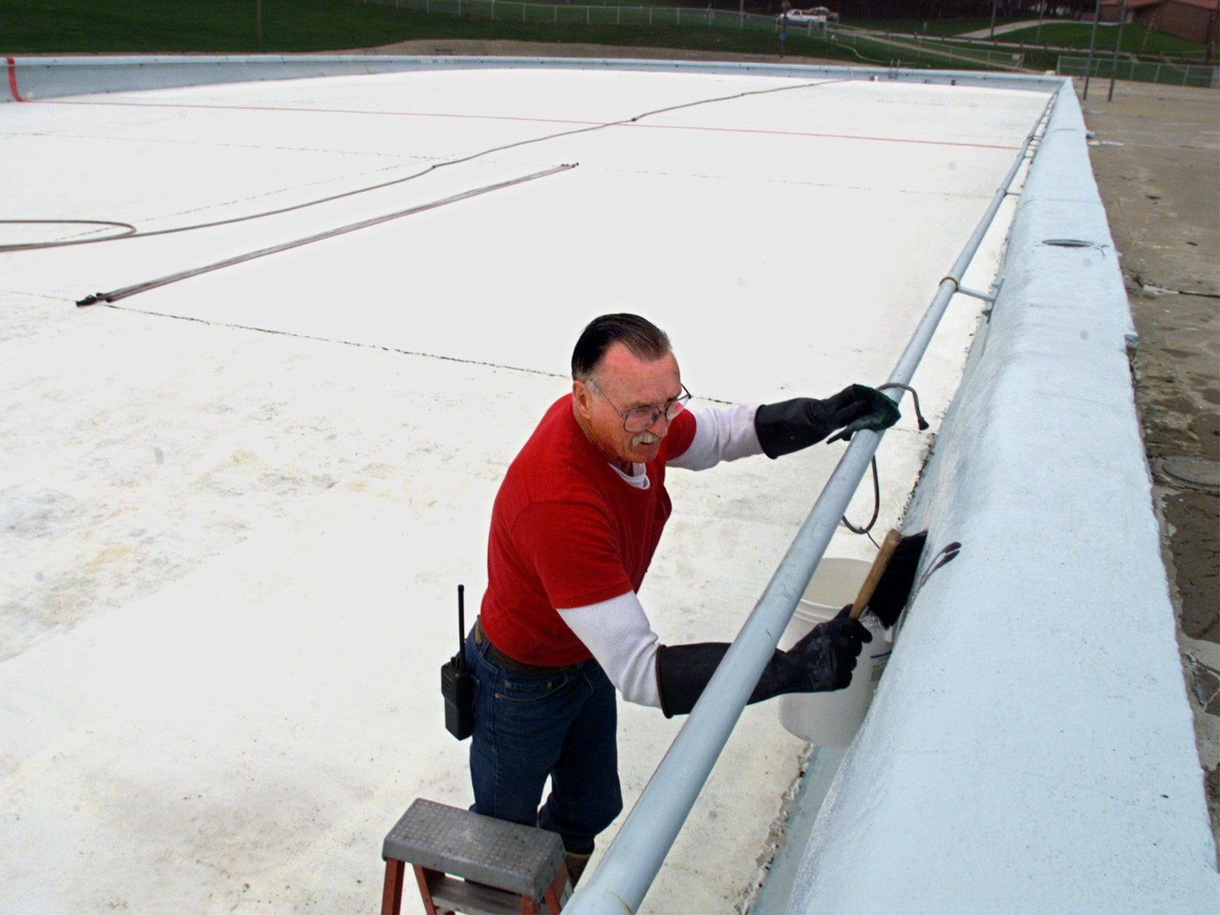 From 1999: Last summer swimmers left a ring around the 350-foot-long pool at Camp Dodge. Fred Sheeks was working to scrub the pool walls before it was filled with nearly 3 million gallons for the 1999 swim season.