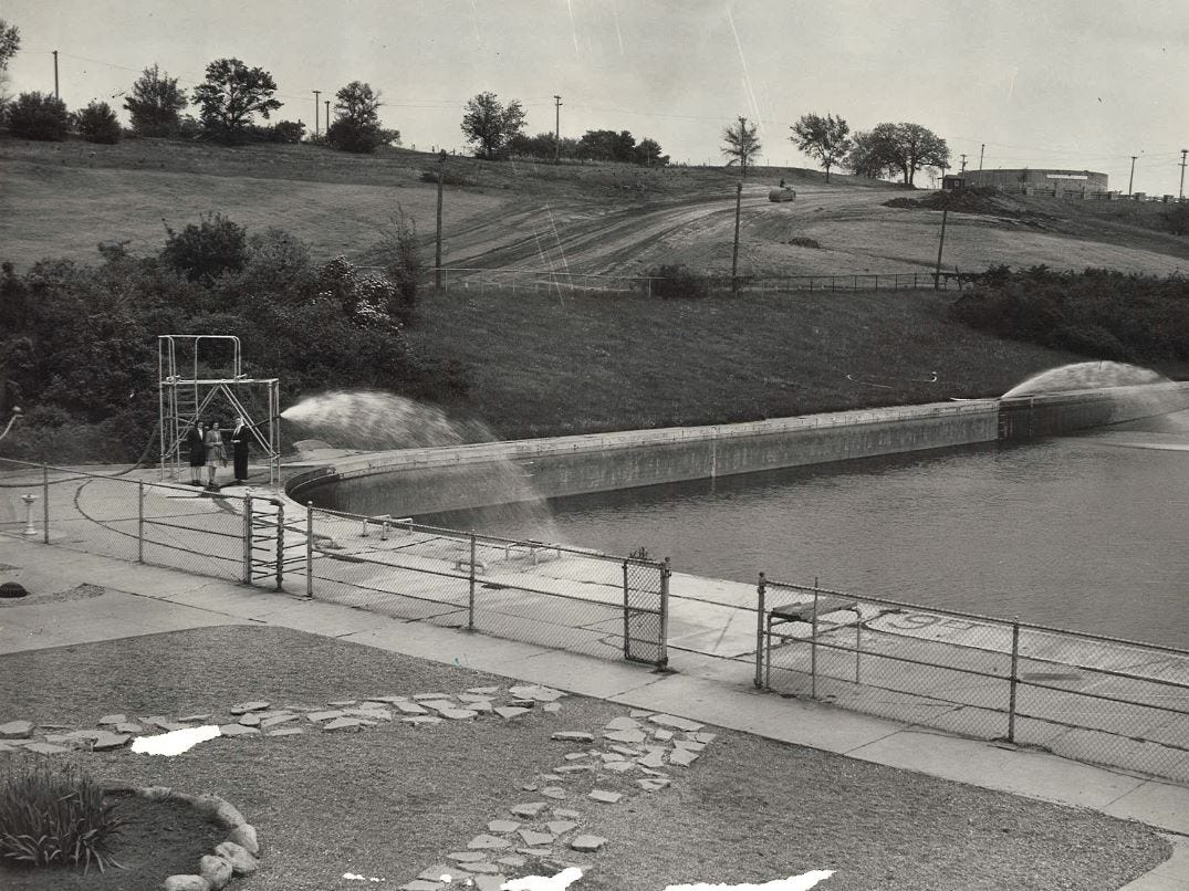 From 1943: Workers fill the 3 million-gallon pool at Camp Dodge before it opens for the 1943 swim season. The road in the background was built as a new public entrance to the pool.