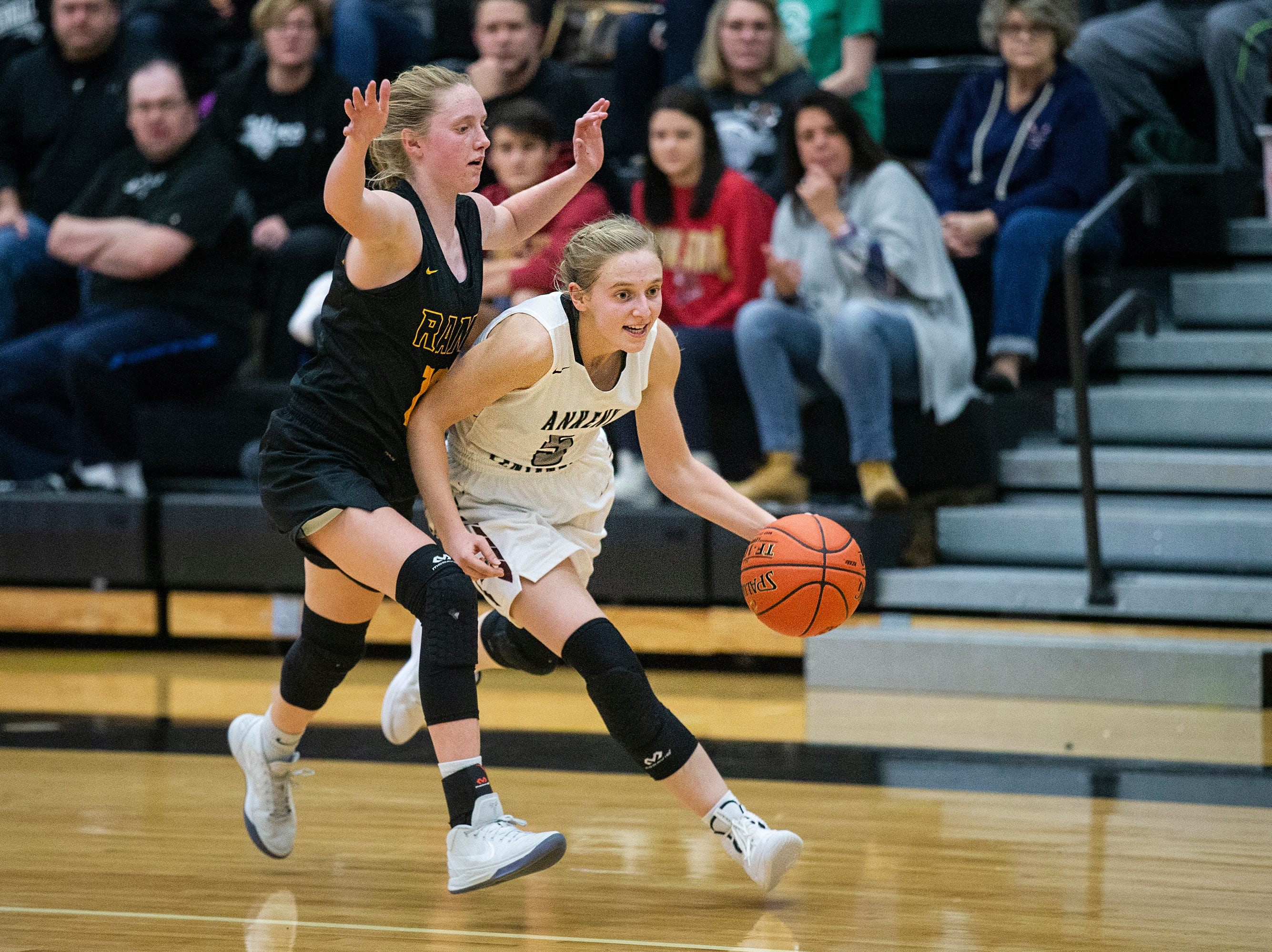 Centennial's Taylor Runchey brings the ball down the court during the Southeast Polk vs. Ankeny Centennial girls' basketball game on Tuesday, Nov. 27, 2018, at Ankeny Centennial High School.