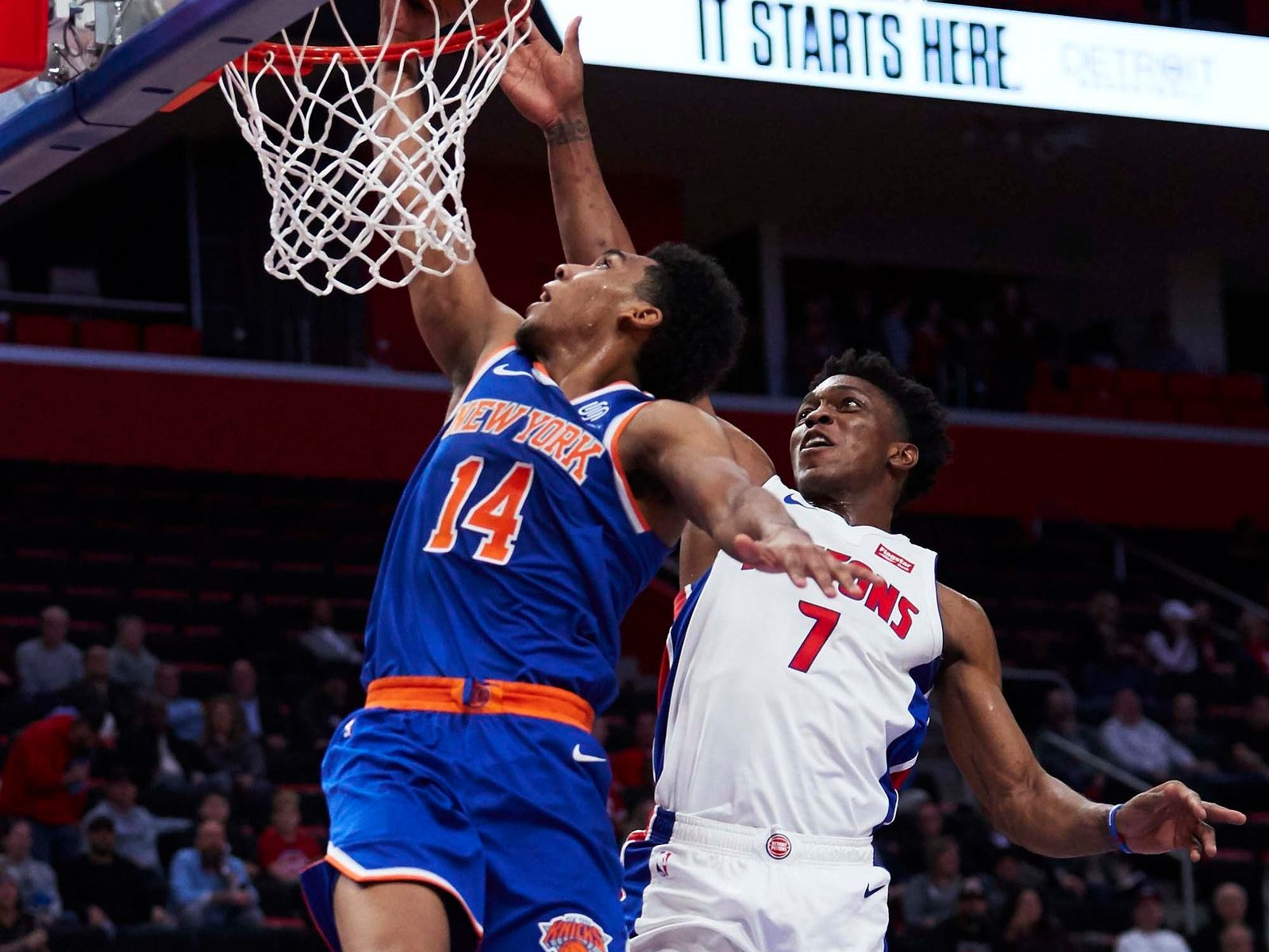 Detroit Pistons forward Stanley Johnson (7) blocks a shot by New York Knicks guard Allonzo Trier (14) in the second half at Little Caesars Arena.