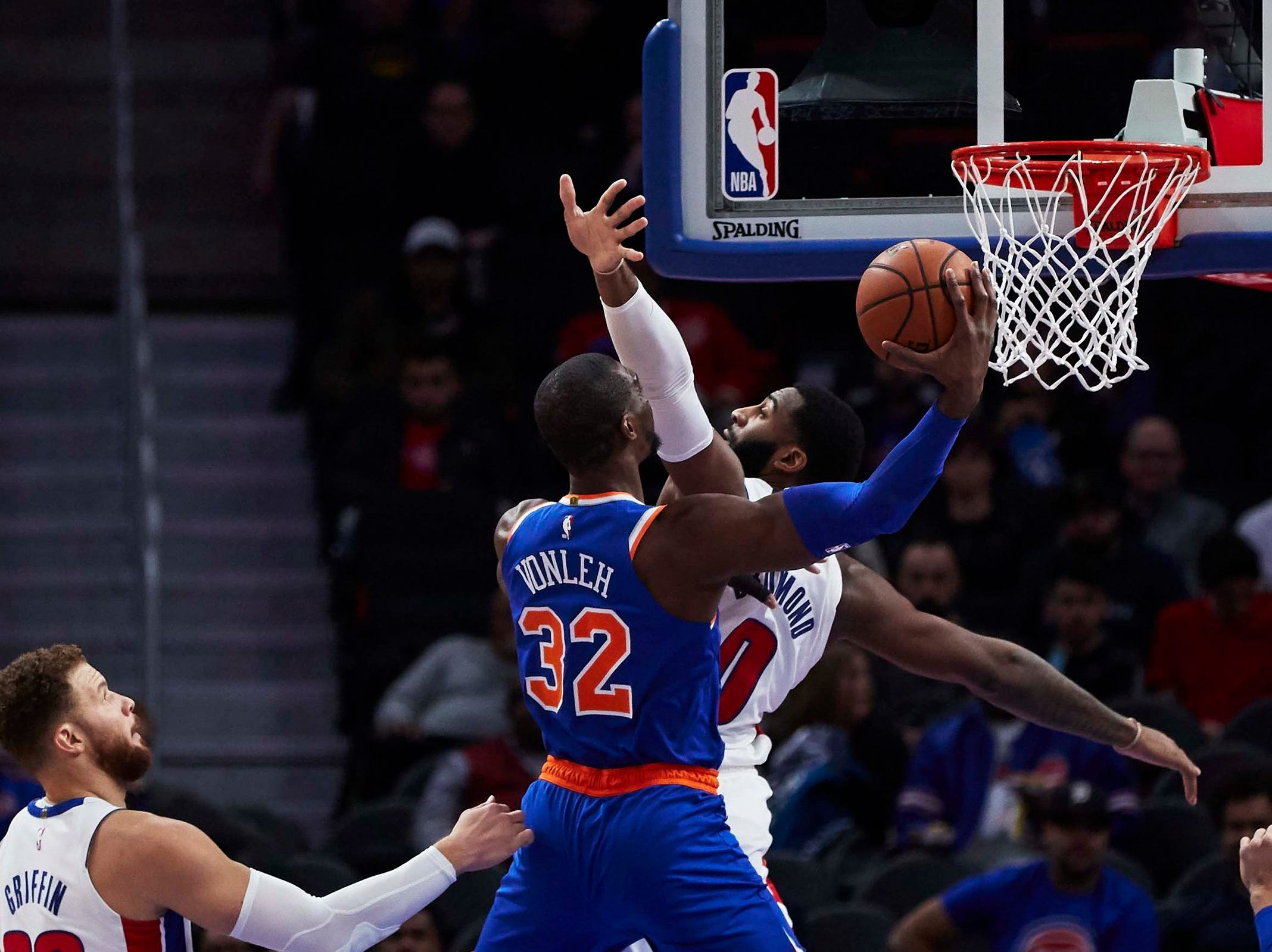 New York Knicks forward Noah Vonleh (32) shoots on Detroit Pistons center Andre Drummond (0) in the first half at Little Caesars Arena.