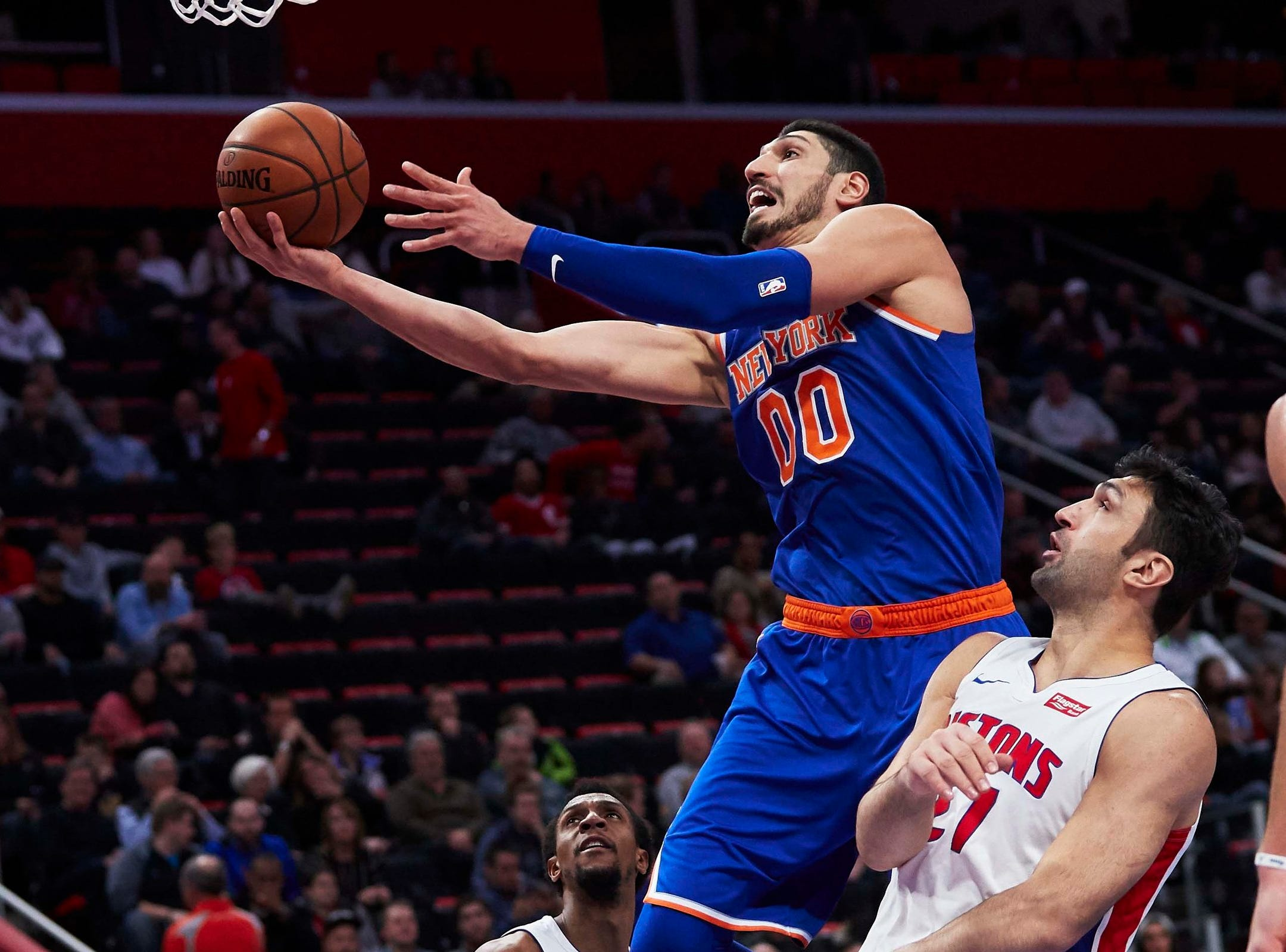 New York Knicks center Enes Kanter (00) goes to the basket on Detroit Pistons center Zaza Pachulia (27) in the second half at Little Caesars Arena.