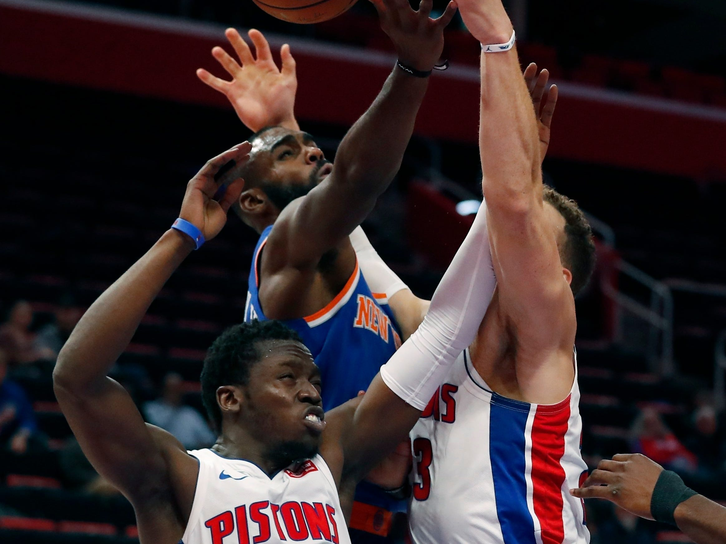 Detroit Pistons guard Reggie Jackson (1), New York Knicks guard Tim Hardaway Jr., and Pistons forward Blake Griffin, right, reach for a rebound during the first half of an NBA basketball game Tuesday, Nov. 27, 2018, in Detroit.
