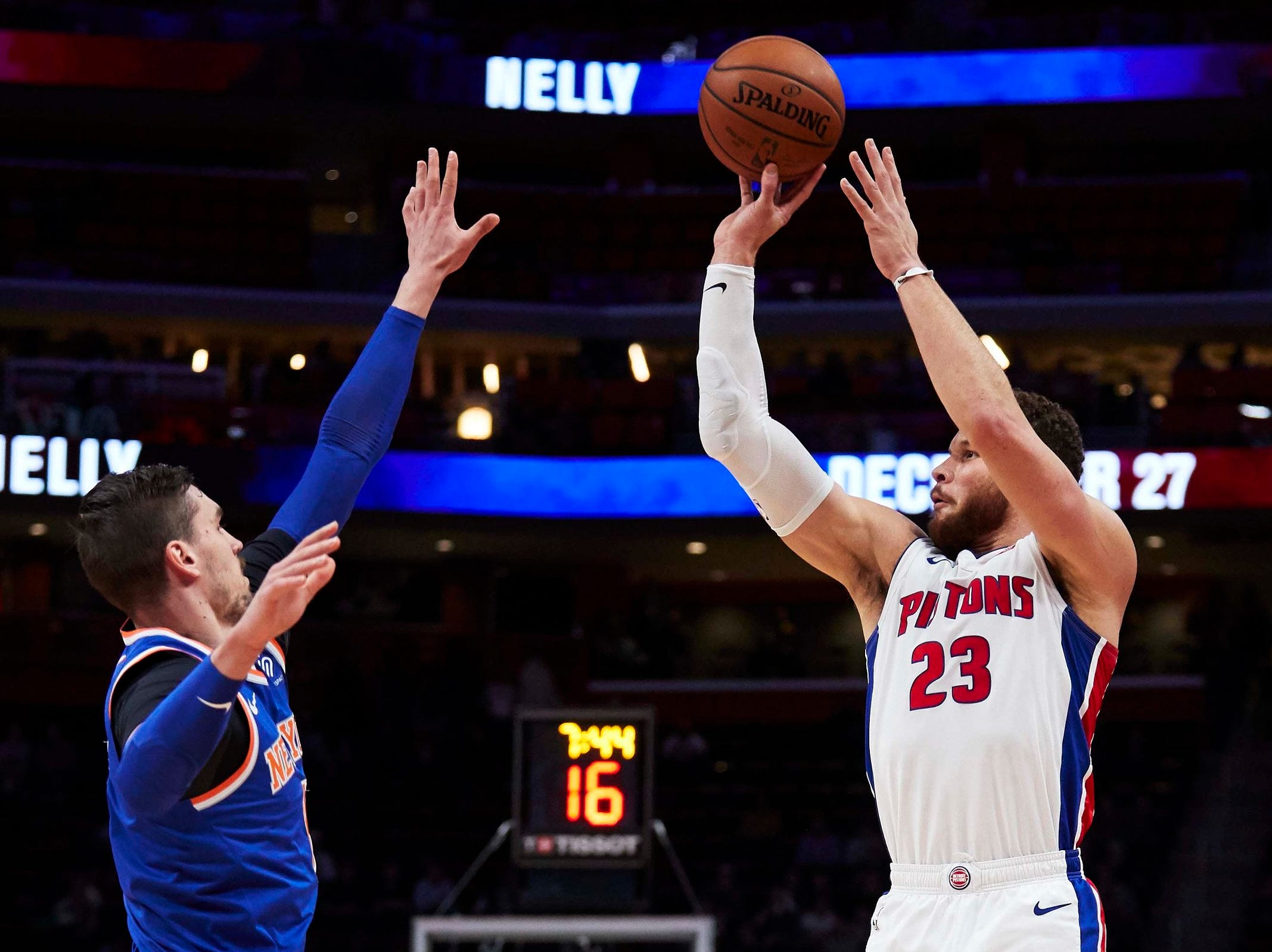 Detroit Pistons forward Blake Griffin (23) shoots on New York Knicks forward Mario Hezonja (8) in the first half at Little Caesars Arena.