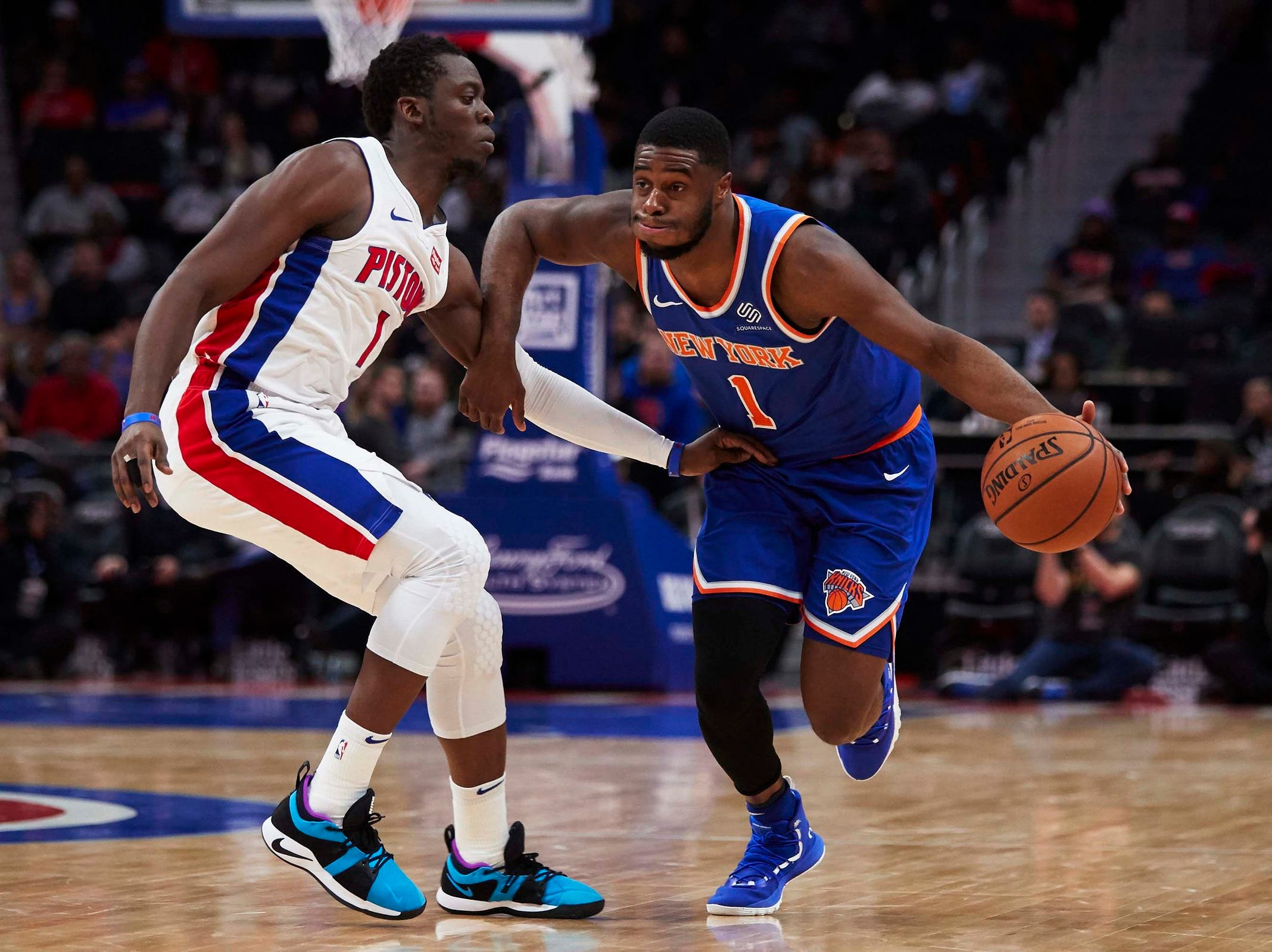 New York Knicks guard Emmanuel Mudiay (1) dribbles defended by Detroit Pistons guard Reggie Jackson (1) in the second half at Little Caesars Arena.