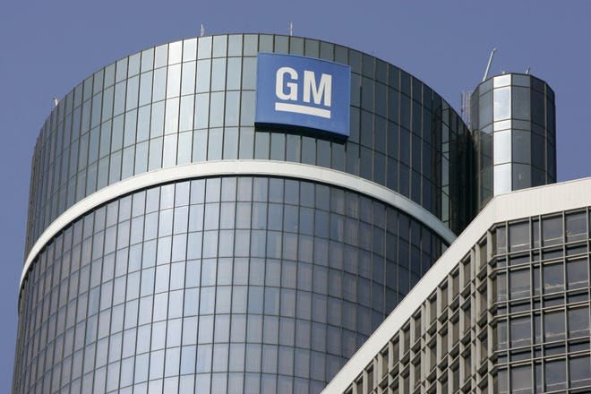 The GM logo is seen on the top of the center tower at the GM Renaissance Center in Detroit.