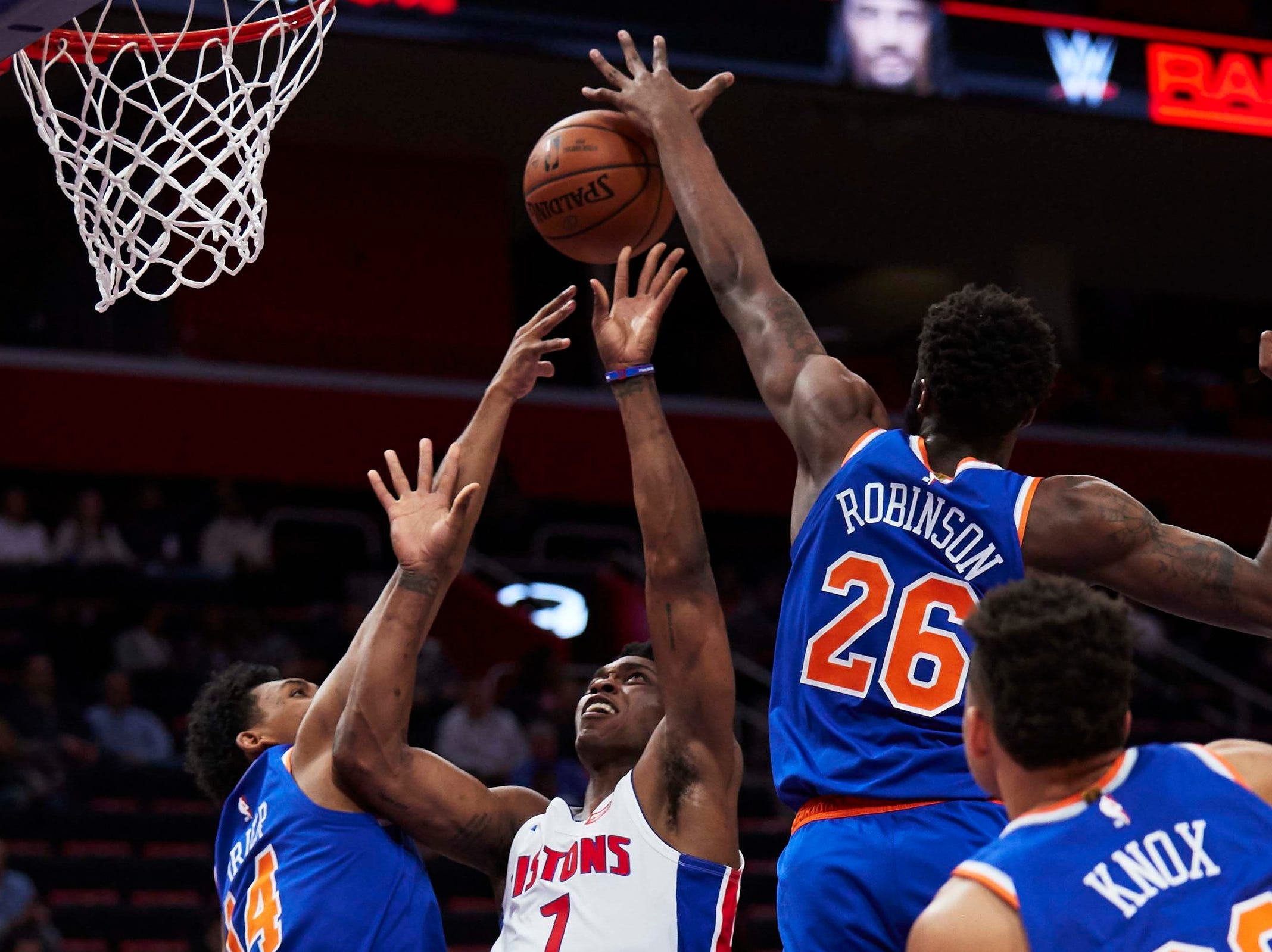 New York Knicks center Mitchell Robinson (26) blocks a shot by Detroit Pistons forward Stanley Johnson (7) in the first half at Little Caesars Arena.
