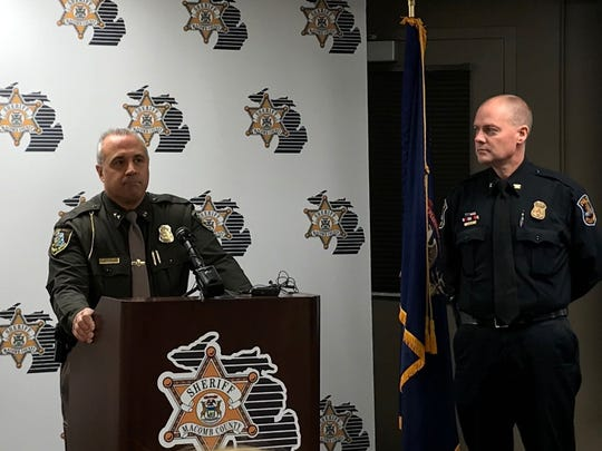 Macomb County Sheriff Anthony Wickersham (left) announces that St. Clair Shores police officers have been cleared in the fatal shooting of a 29-year-old Detroit man on Nov. 3.