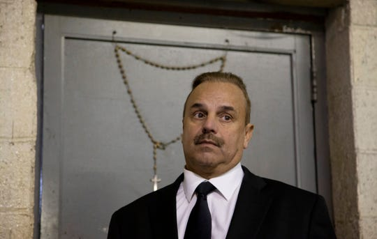 Robert Carmack, a Detroit businessman whose agitation campaign against Duggan went public earlier this month, holds a press conference at his collision shop in Detroit Wednesday, Nov. 28, 2018.