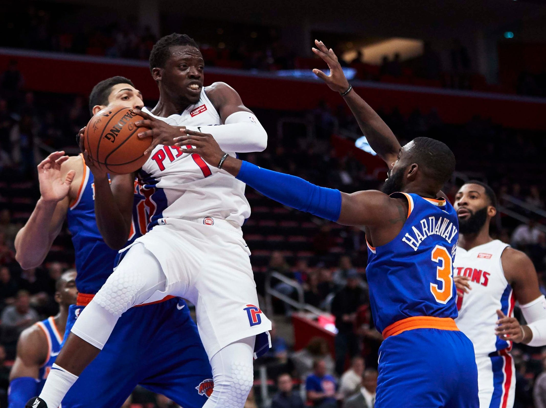 Detroit Pistons guard Reggie Jackson (1) passes defended by New York Knicks guard Tim Hardaway Jr. (3) in the first half at Little Caesars Arena.