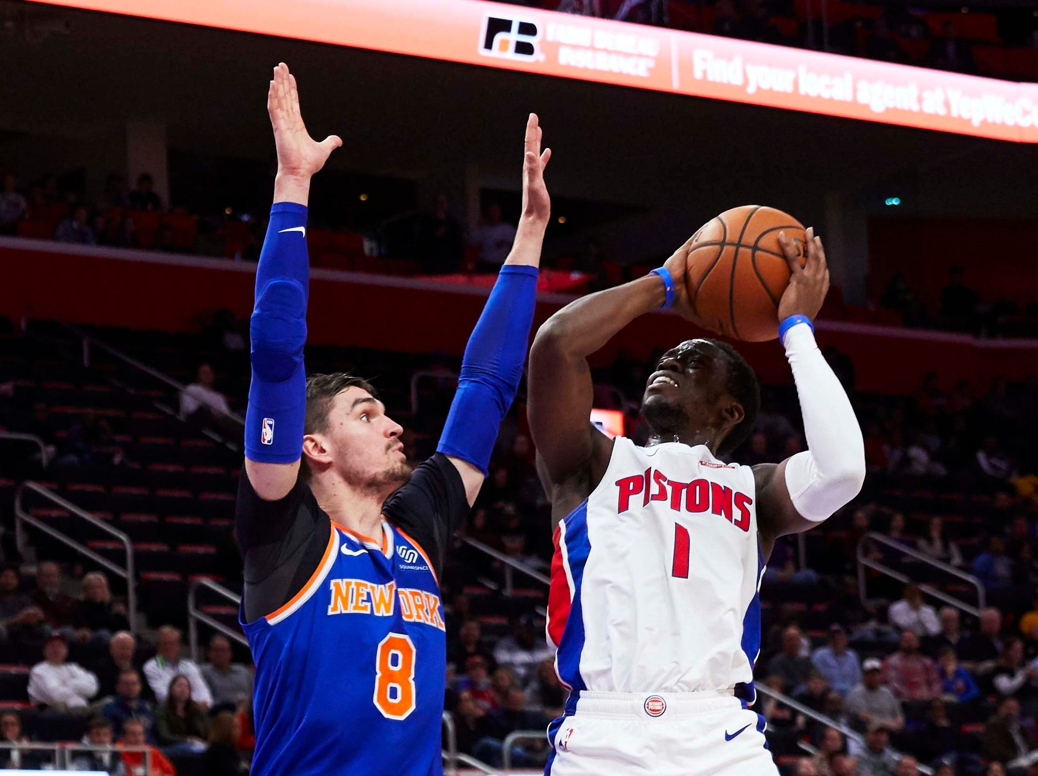 Detroit Pistons guard Reggie Jackson (1) shoots on New York Knicks forward Mario Hezonja (8) in the first half at Little Caesars Arena.