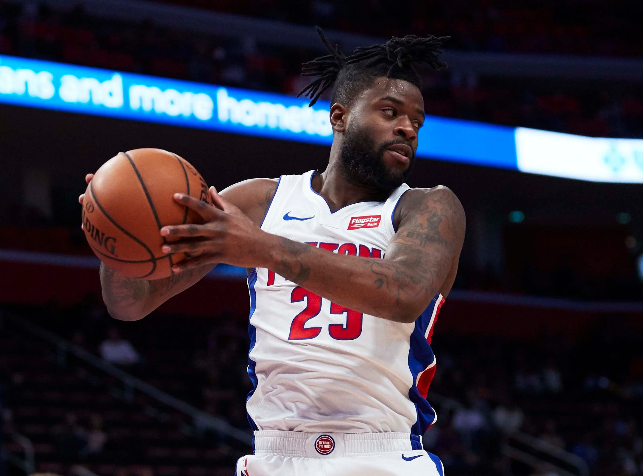 Detroit Pistons guard Reggie Bullock (25) grabs the rebound in the second half against the New York Knicks at Little Caesars Arena.