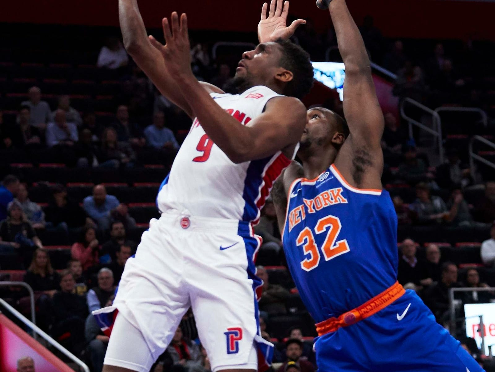 Detroit Pistons guard Langston Galloway (9) shoots on New York Knicks forward Noah Vonleh (32) in the first half at Little Caesars Arena.