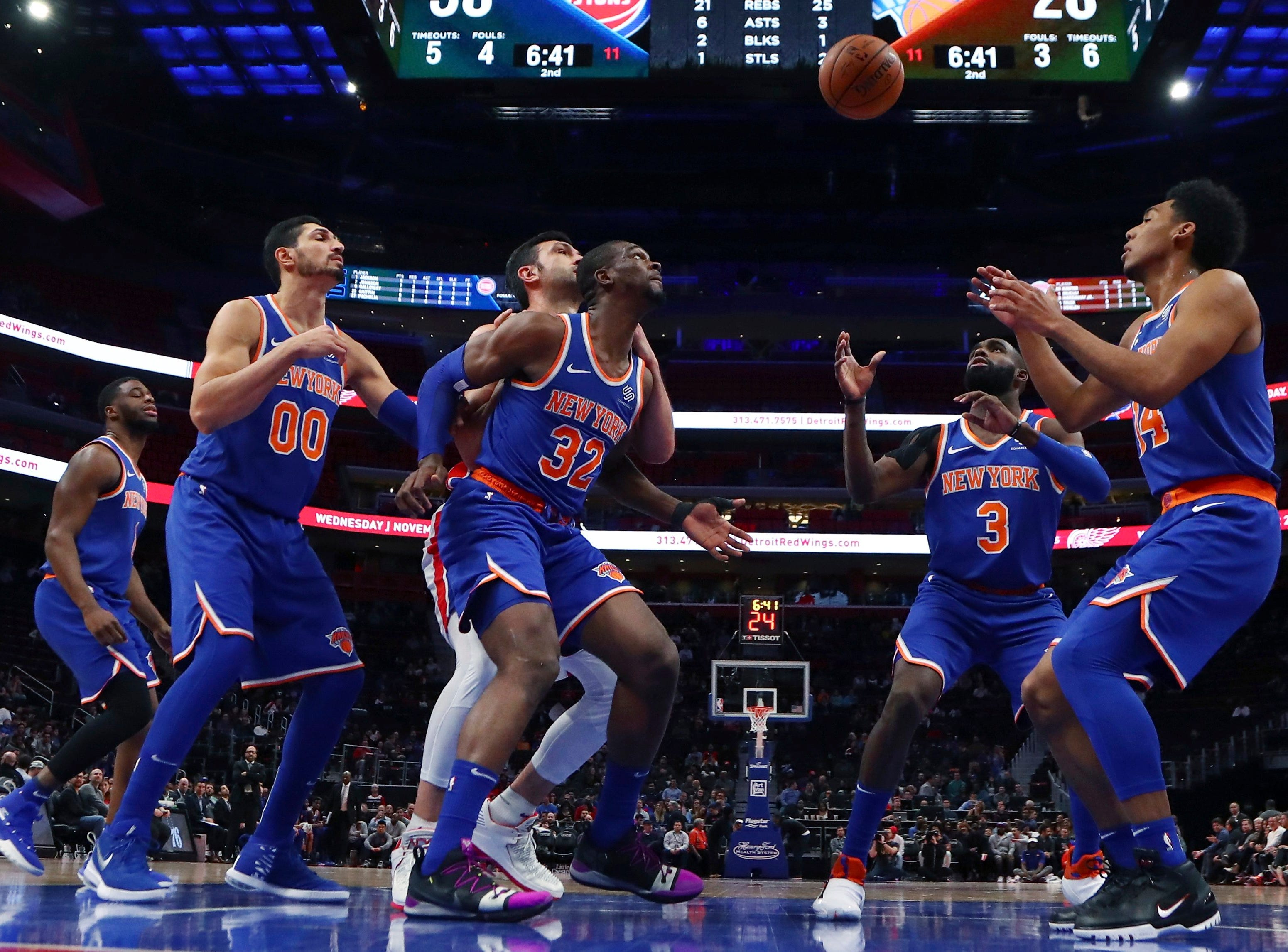New York Knicks center Enes Kanter (00), forward Noah Vonleh (32) and guards Tim Hardaway Jr. (3) and Allonzo Trier (14) wait on the ball after the Detroit Pistons scoredduring the first half of an NBA basketball game, Tuesday, Nov. 27, 2018, in Detroit.
