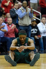 Michigan State Spartans guard Cassius Winston (5) reacts after picking up his fifth foul during the second half against the Louisville Cardinals at KFC Yum! Center. Louisville defeated Michigan State 82-78.