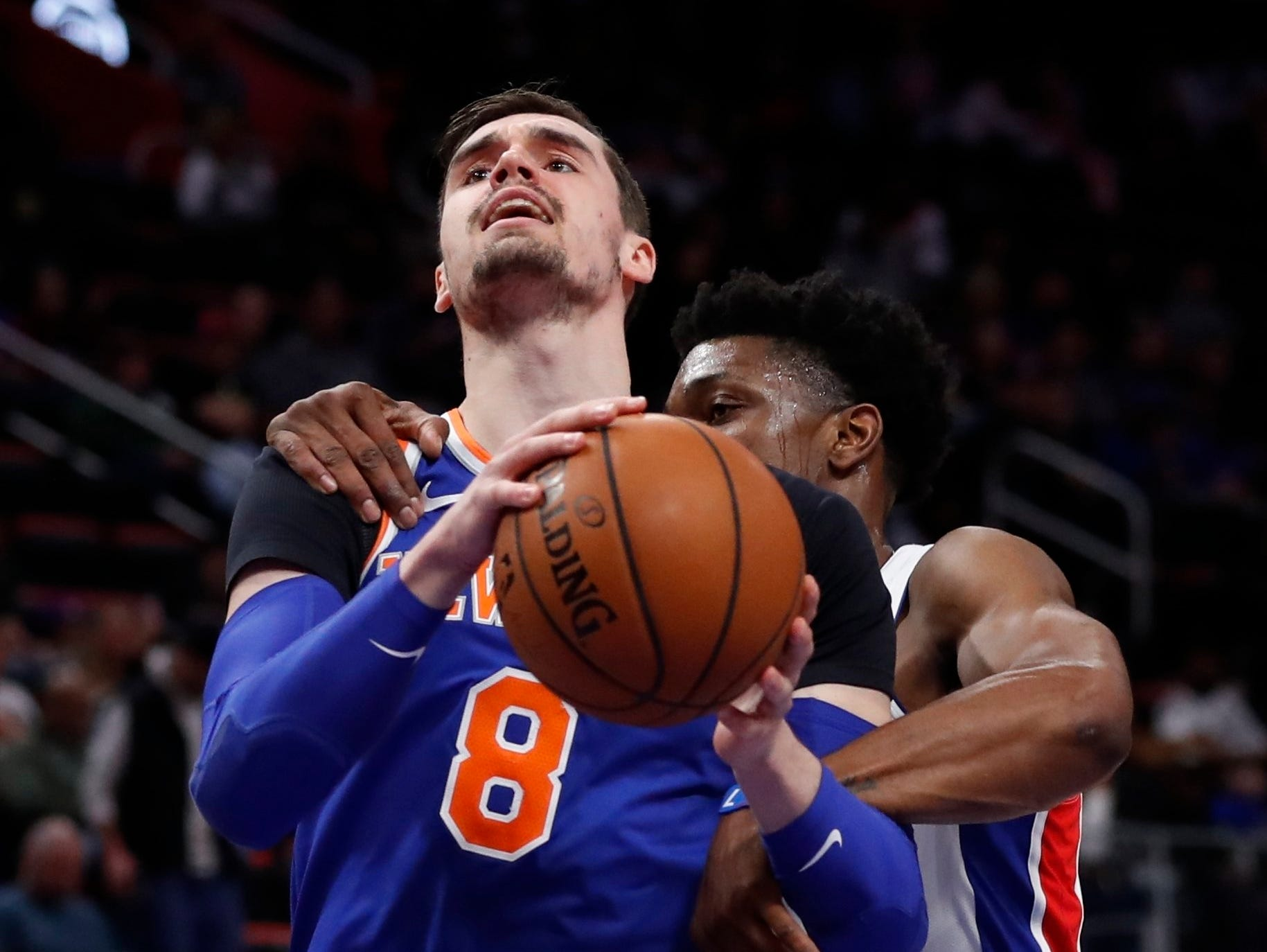 New York Knicks forward Mario Hezonja (8) is fouled by Detroit Pistons forward Stanley Johnson during the first half of an NBA basketball game Tuesday, Nov. 27, 2018, in Detroit.