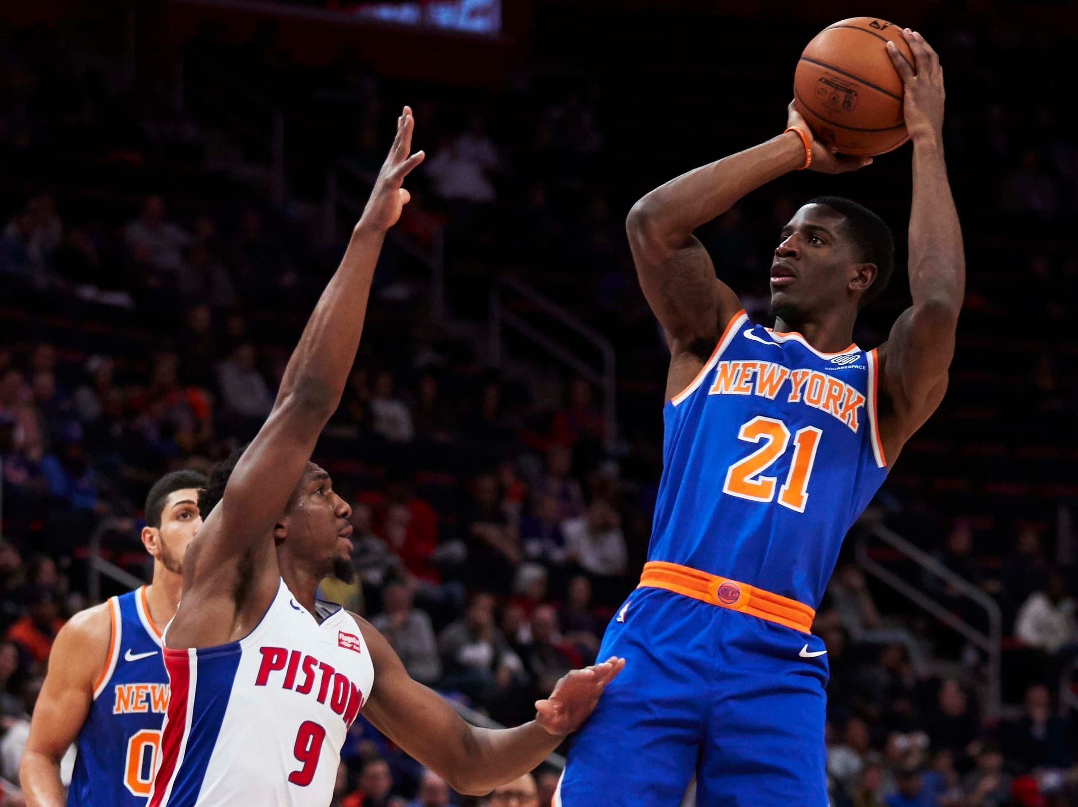 New York Knicks guard Damyean Dotson (21) shoots over Detroit Pistons guard Langston Galloway (9) in the second half at Little Caesars Arena.