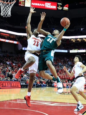 Nick Ward #44 of the Michigan State Spartans shoots the ball against the Louisville Cardinals at KFC YUM! Center on November 27, 2018 in Louisville, Kentucky.