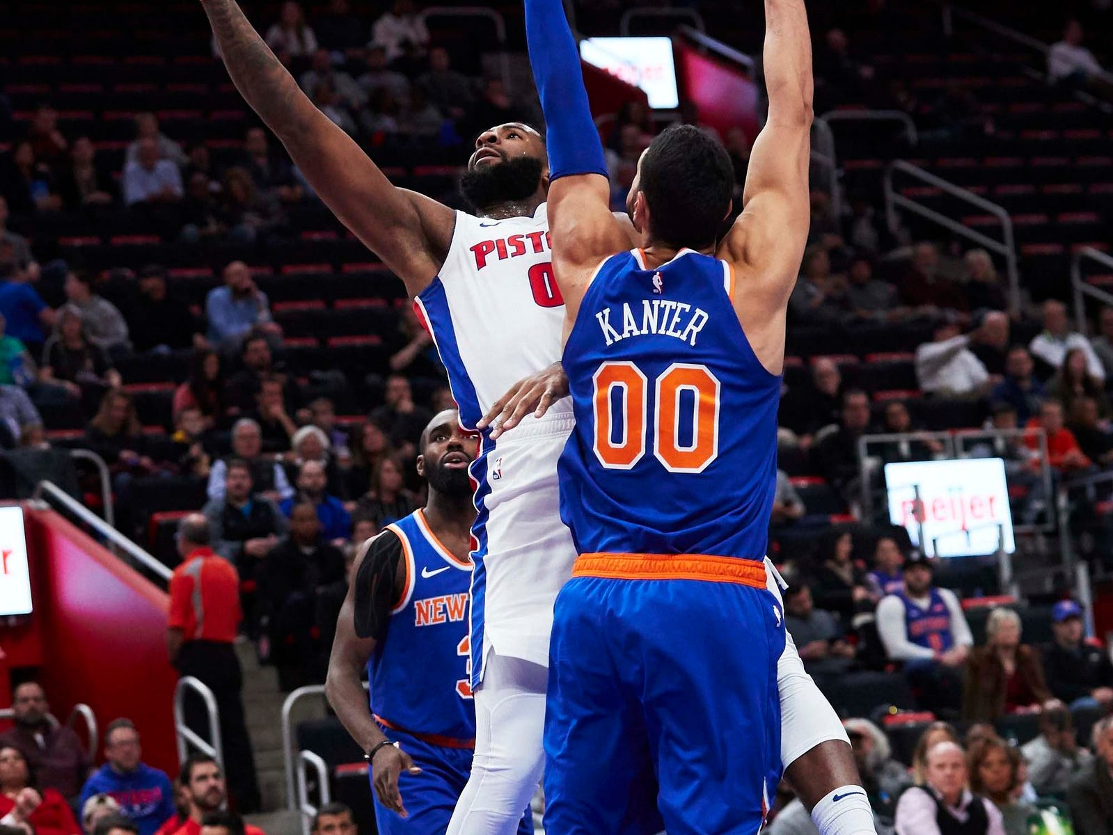 Detroit Pistons center Andre Drummond (0) shoots on New York Knicks center Enes Kanter (00) in the first half at Little Caesars Arena.