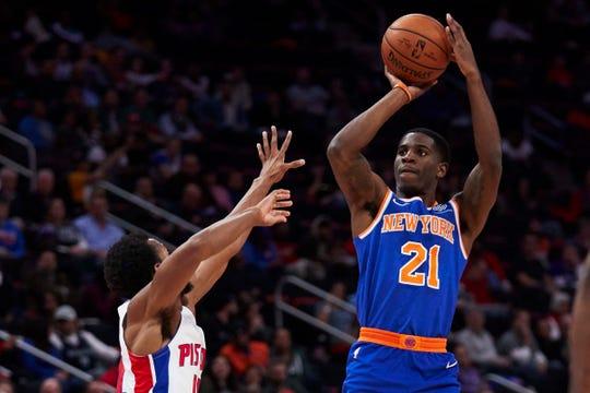 Knicks guard Damyean Dotson shoots on Pistons guard Ish Smith at Little Caesars Arena.