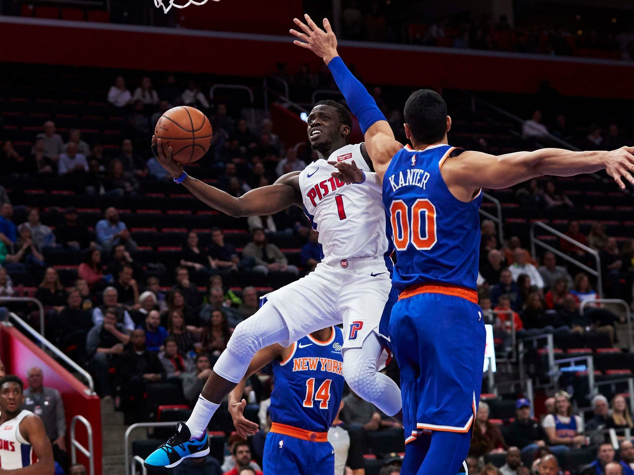 Detroit Pistons guard Reggie Jackson (1) shoots on New York Knicks center Enes Kanter (00) in the first half at Little Caesars Arena.