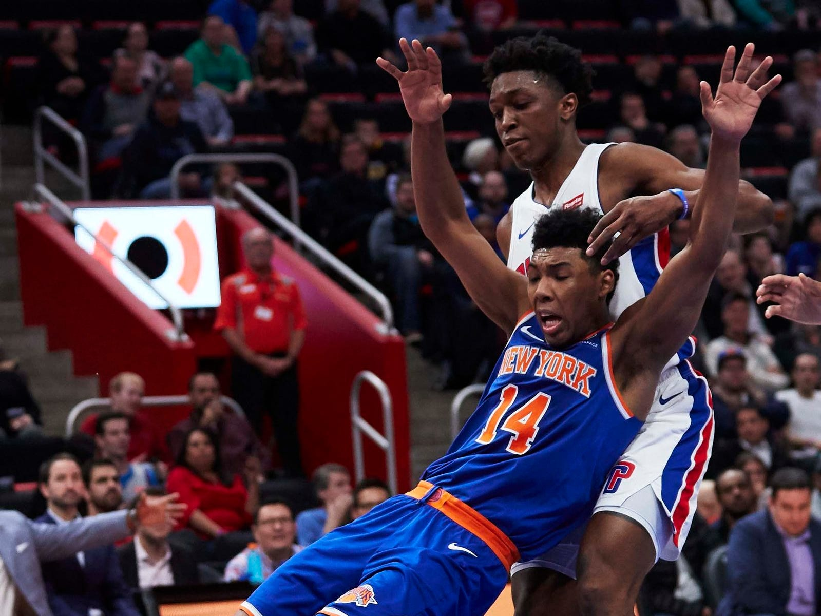 New York Knicks guard Allonzo Trier (14) is fouled by Detroit Pistons forward Stanley Johnson (7) in the second half at Little Caesars Arena.