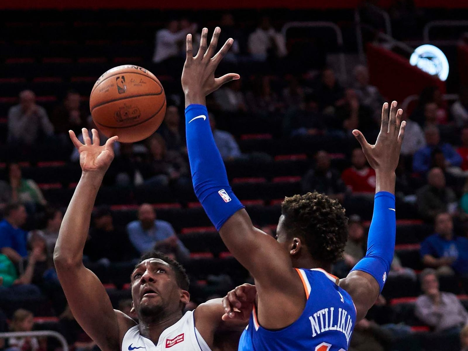 Detroit Pistons guard Langston Galloway (9) shoots defended by New York Knicks guard Frank Ntilikina (11) in the first half at Little Caesars Arena.
