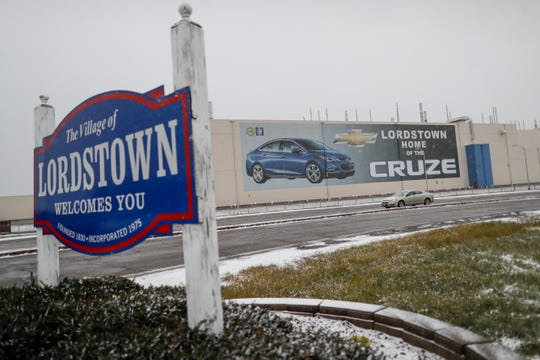 The GM plant in Lordstown, Ohio, is targeted to be idled in 2019, as part of a GM restructuring. A banner depicting the Chevrolet Cruze model vehicle is displayed at the Lordstown plant on Nov. 27, 2018.