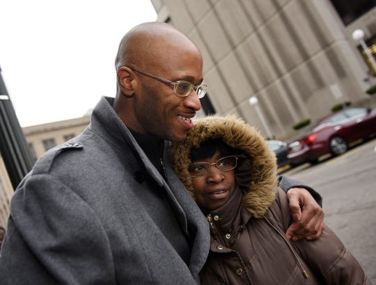 Justly Johnson, 44, hugs his mother Tisah Johnson after his release from the Wayne County jail Wednesday after spending nearly 20 years in prison for a murder that he didn't commit.