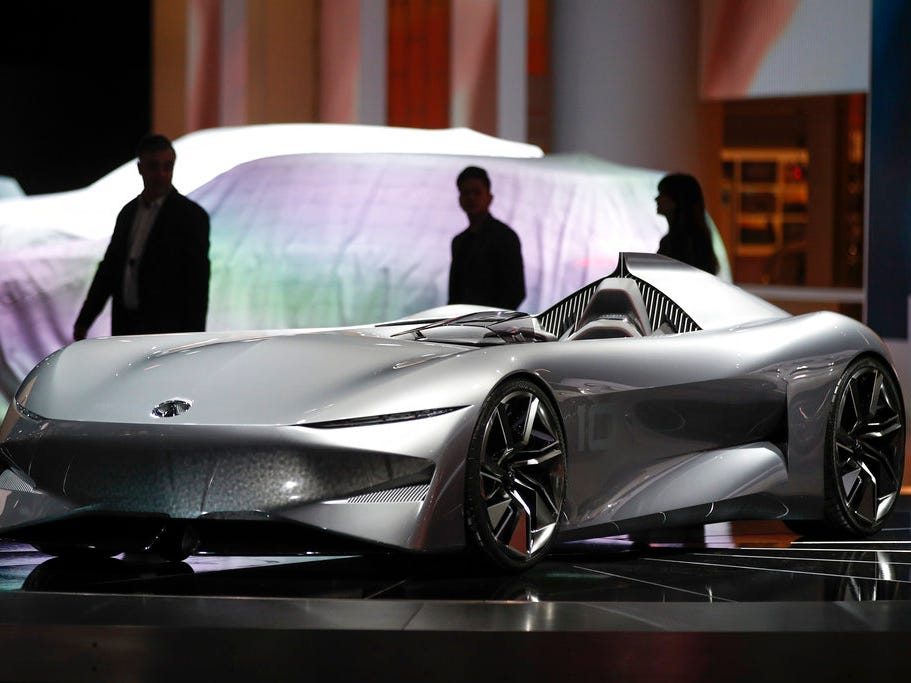 Attendees walk past the Infiniti Prototype 10 concept at the Los Angeles Auto Show, Wednesday, Nov. 28, 2018.