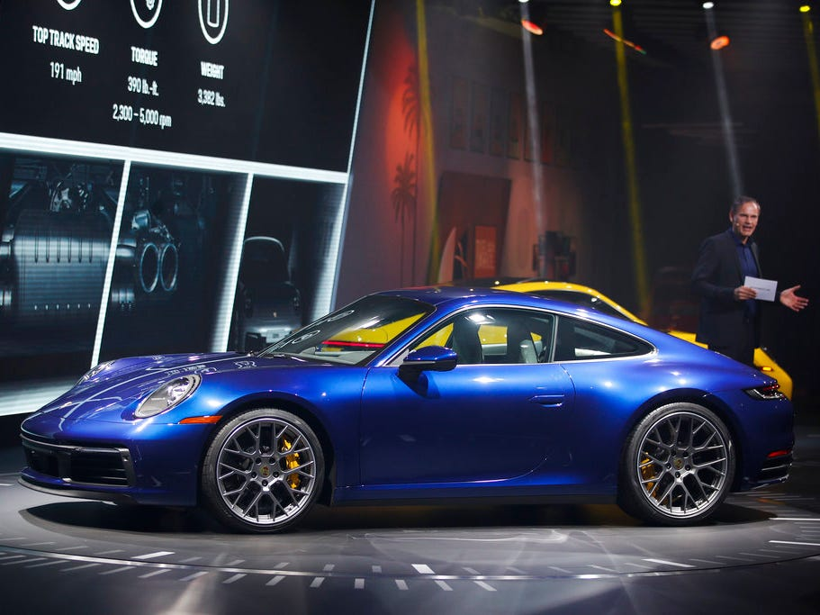Porsche AG CEO Oliver Blume introduces the 2020 Porsche 911 models during a news conference at the Los Angeles Auto Show on Wednesday.