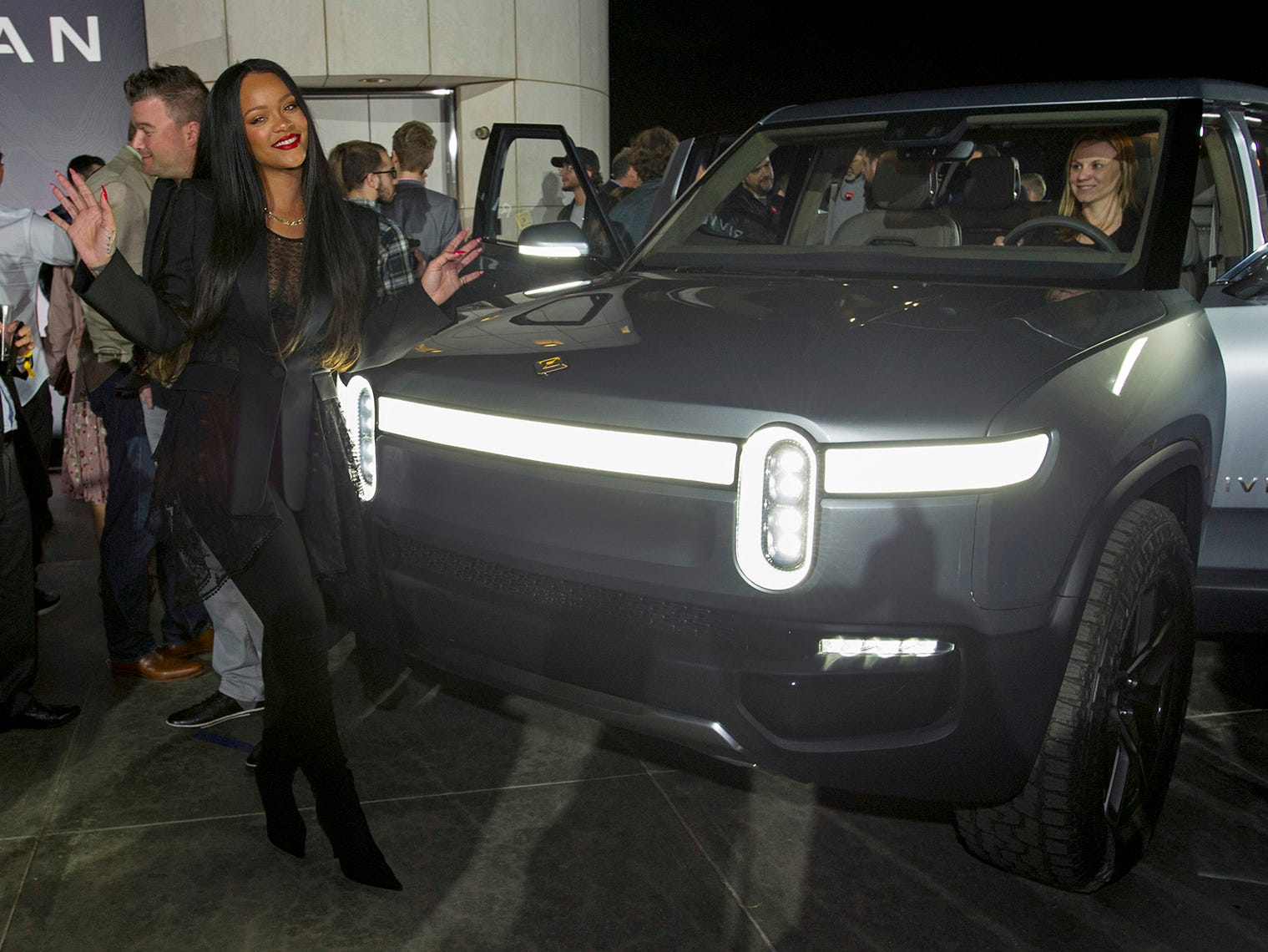 Rihanna poses for a photo during Rivian's unveiling of the first-ever electric adventure vehicle before it's official reveal at the LA Auto Show.