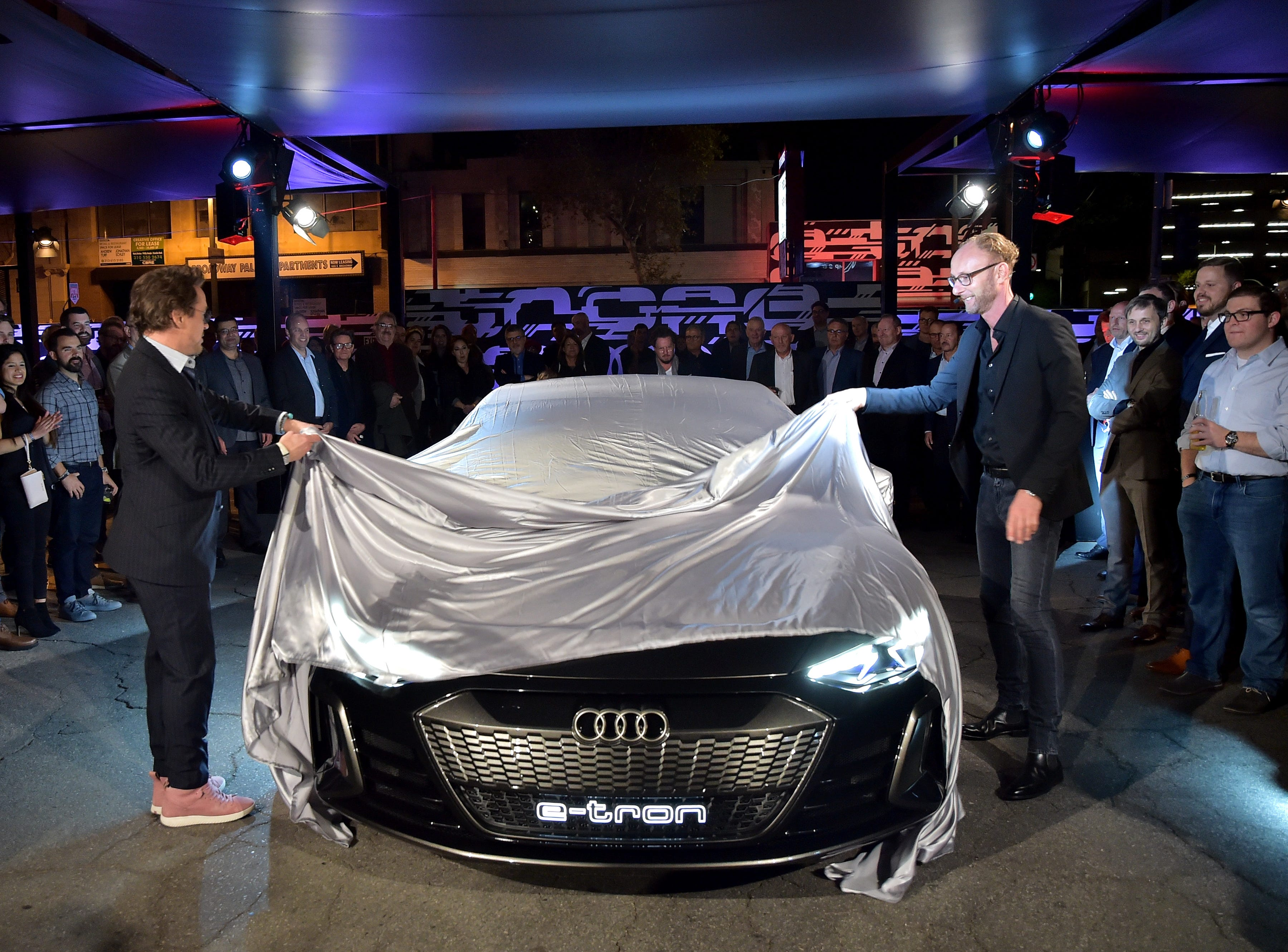 Robert Downey Jr. (L) and Head of Design of Audi AG, Marc Lichte attend the global reveal of the Audi e-tron GT concept in Los Angeles on Monday, November 26th, 2018.