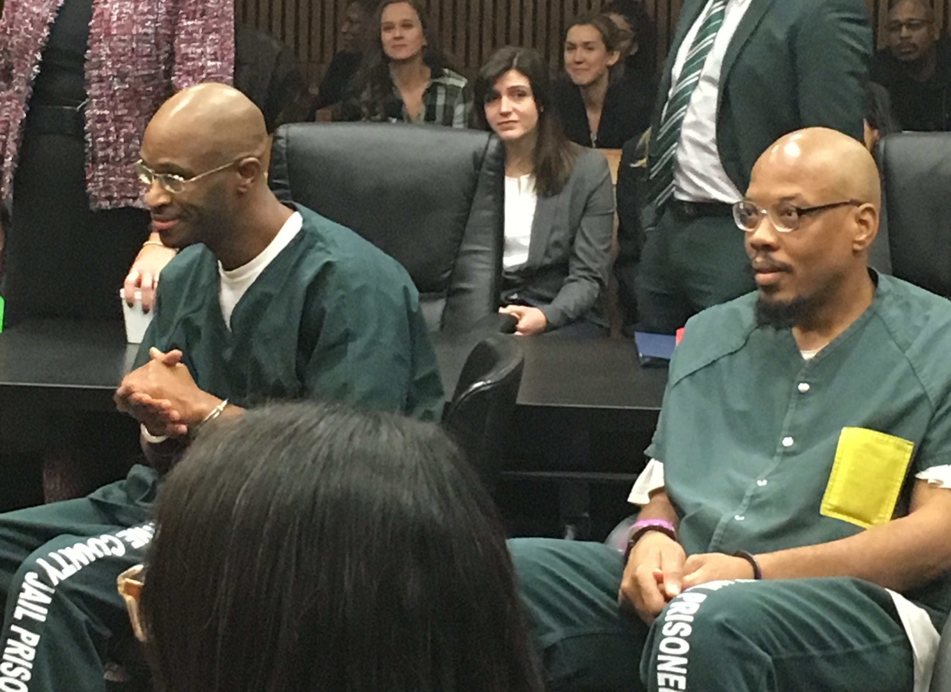 Justly Johnson, left, and Kendrick Scott listen in court Wednesday as they are exonerated.  They spent years in prison on a murder conviction for a 1999 Mother's Day slaying.