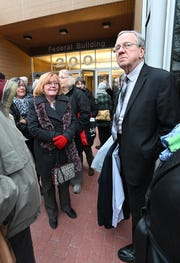Gary Benjamin and Melody Hart wait for ACLU attorneys outside federal court in Ann Arbor on Wednesday.