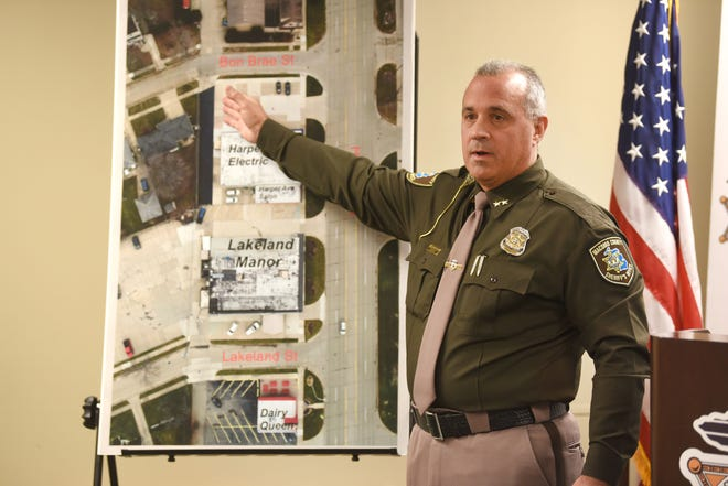 Macomb County Sheriff Anthony Wickersham points to the location of an officer-involved shooting during a news conference at the Sheriffs office in Mt. Clemens on Wednesday.