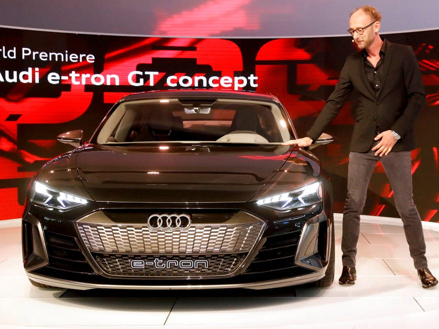 Marc Lichte, head of design, Audi AG talks about the Audi e-tron GT concept car during the Los Angeles Auto Show on Wednesday, Nov. 28, 2018, in Los Angeles.