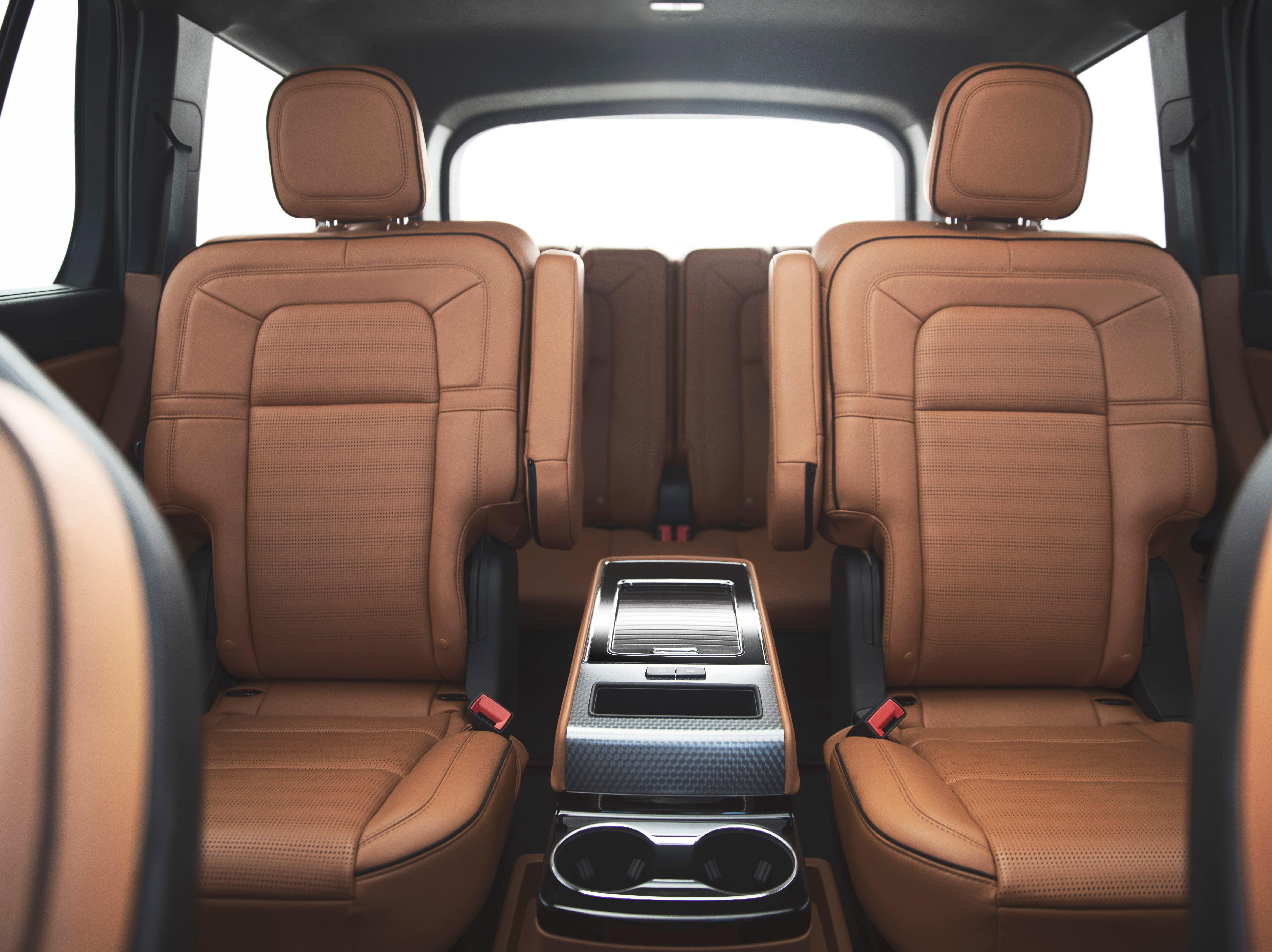 Backseat passengers get their own, five-inch control touchscreen and the roomy third-row is accessed with a simple push of a button atop the seat.