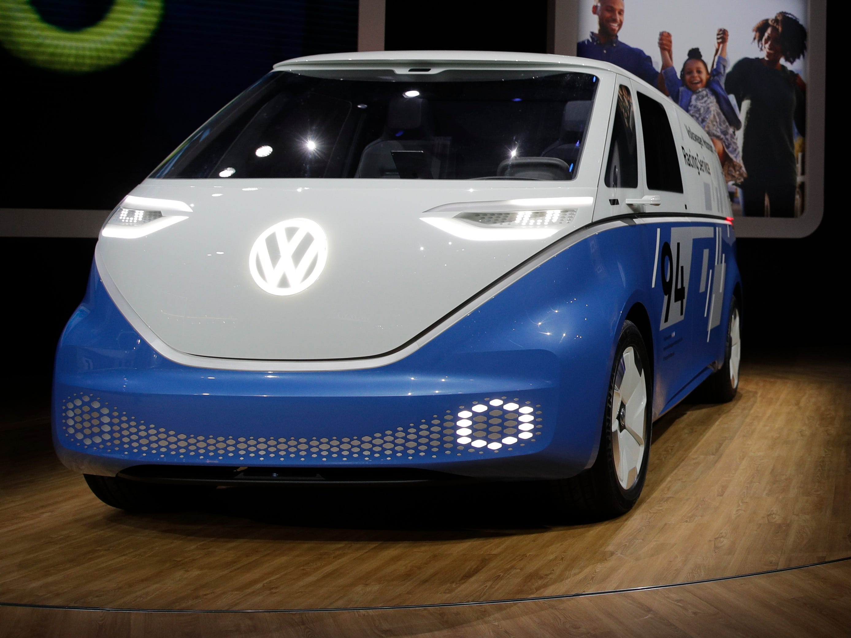The Volkswagen Buzz Cargo concept, left, is unveiled at the Los Angeles Auto Show on Wednesday, Nov. 28, 2018.