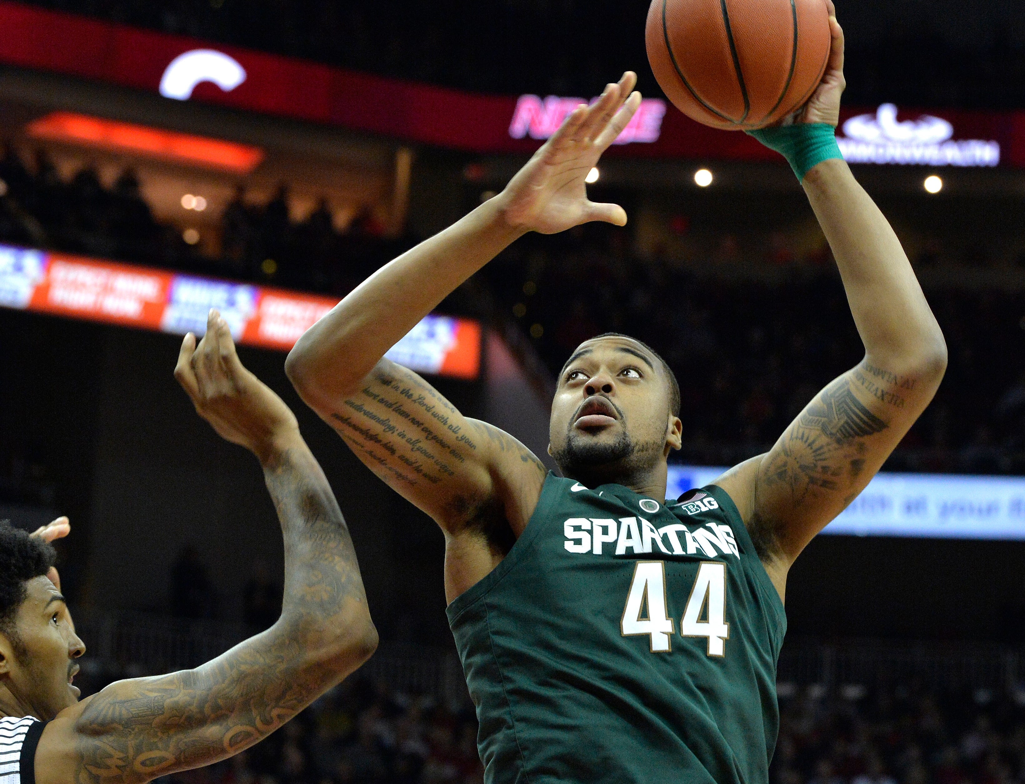 Michigan State forward Nick Ward (44) puts up a shot over Louisville center Malik Williams (5) during the first half.