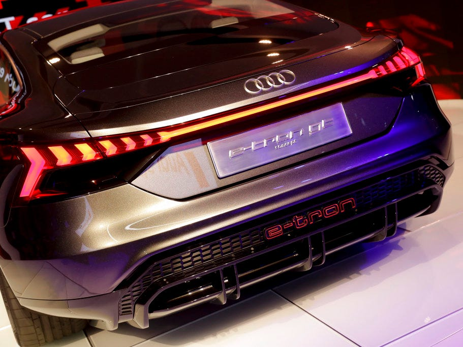 Light is reflected off an Audi e-tron GT concept car.